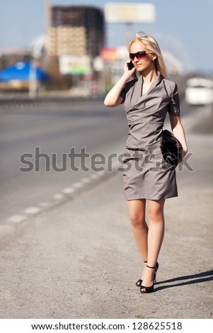 Happy young woman calling on the phone - stock photo