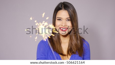 Happy young woman celebrating at a party