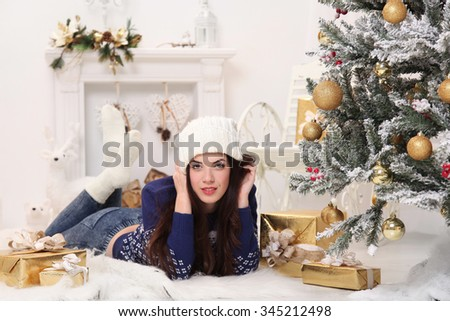 happy young woman celebrating Christmas at home - stock photo