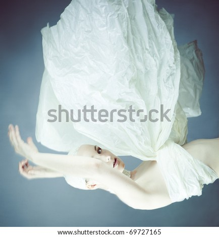 happy young woman dreams to fly - stock photo