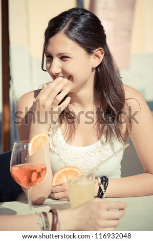Happy Young Woman Drinking , Italy - stock photo