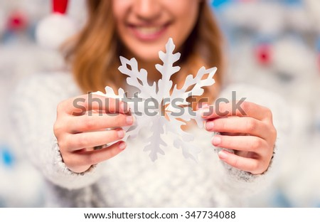 Happy young woman during the celebration of Christmas, Christmas tree background - stock photo