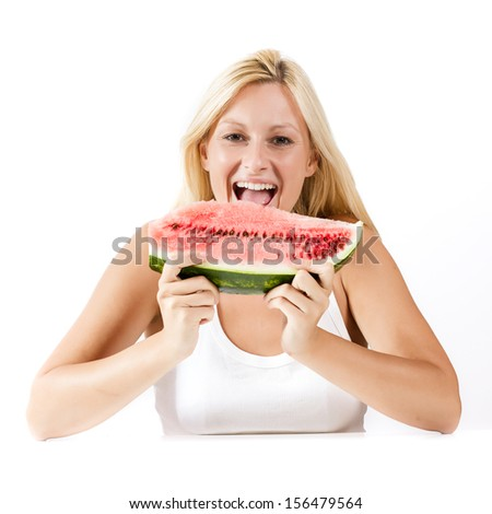 Happy young woman eating fresh watermelon. - stock photo