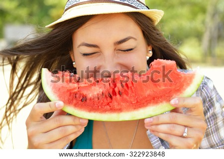 Happy young woman eating watermelon on the beach. Youth lifestyle. Happiness, joy, holiday, beach, summer concept.  - stock photo