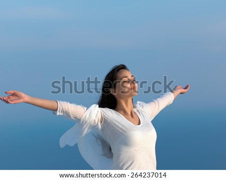 happy young woman enjoy sunset while dancing and enjoy music on headphones - stock photo