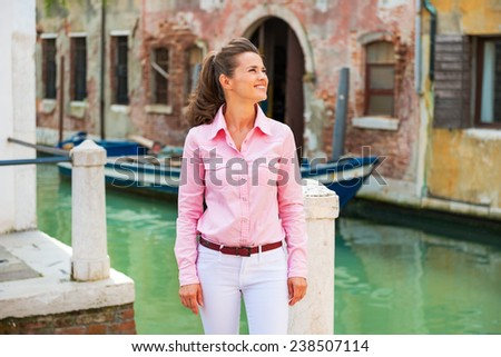 Happy young woman enjoying being in venice, italy
