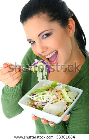 happy young woman enjoying her salad. healthy lifestyle