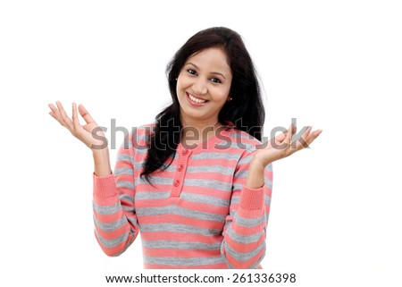 Happy young woman gesturing an open hands against white background - stock photo