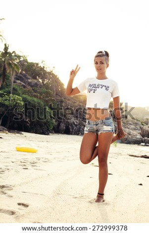 Happy young woman having fun time on beach.  Outdoors lifestyle portrait of girl