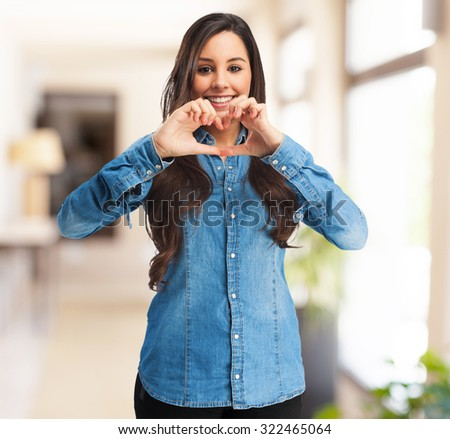 happy young woman heart symbol - stock photo