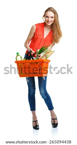 Happy young woman holding a basket full of healthy food. Shopping