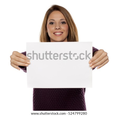 happy young woman holding a blank sheet of paper for advertising