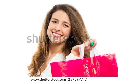 Happy young woman holding a shopping bag