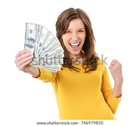 Happy young woman holding and gesturing with money - us dollars - loan, savings and lottery concept