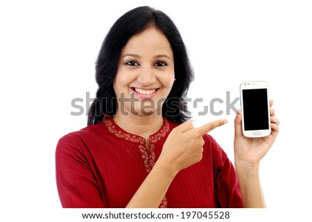 Happy young woman holding black display of smart phone against white background - stock photo