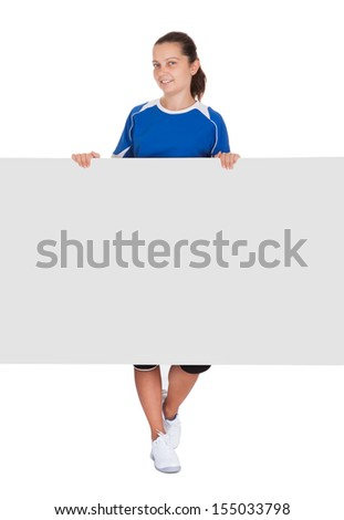 Happy young woman holding blank placard on white background - stock photo