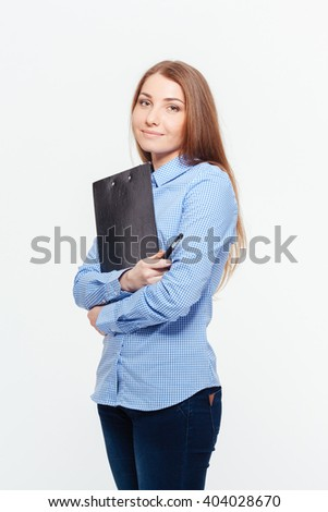 Happy young woman holding clipboard and looking at camera isolated on a white background - stock photo