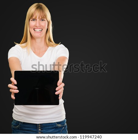 Happy Young Woman Holding Digital Tablet against a black background