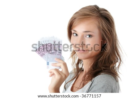 Happy young woman holding euro money isolated on white - loan concept - stock photo