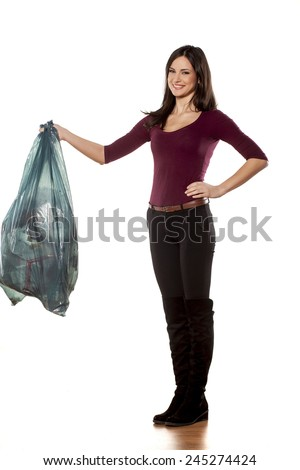 happy young woman holding garbage bag on white background - stock photo