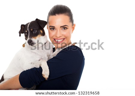 happy young woman holding her pet dog on white background - stock photo