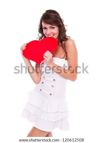 Happy young woman holding red heart in hand over white background - stock photo
