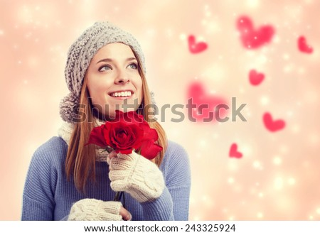 Happy young woman holding red roses with hearts - stock photo