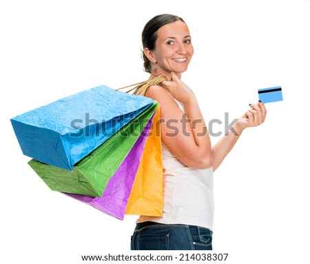 Happy young woman holding shopping bags and credit card on a white background