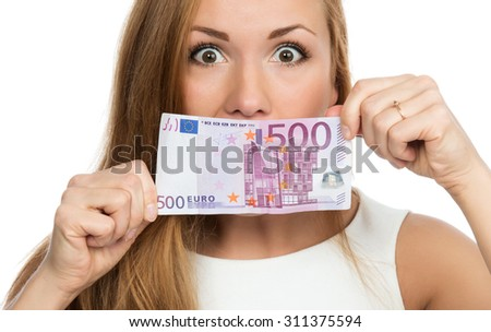Happy young woman holding up cash money five hundred euro in one note in hands yelling and looking at the camera isolated on a white background - stock photo