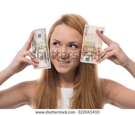 Happy young woman holding up cash money five one fifty euro in one hand and dollars in other compare thinking looking at the corner isolated on a white background - stock photo