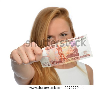 Happy young woman holding up cash money five thousand russian rubles note in hand looking at the camera isolated on a white background - stock photo