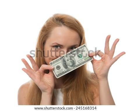 Happy young woman holding up cash money of one hundred dollars in hand  isolated on a white background - stock photo