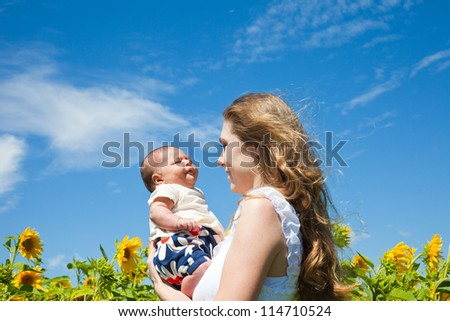happy young woman holds the  child