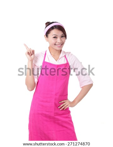Happy young woman housewife showing something Wearing Kitchen Apron Over White Background, asian - stock photo