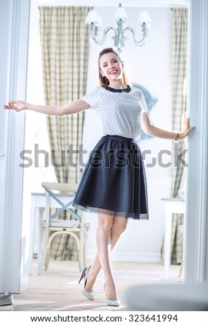 Happy young woman in a stylish interior - stock photo