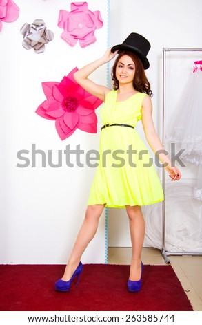 Happy young woman in a top hat - stock photo