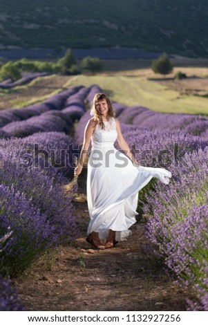 stock-photo-happy-young-woman-in-a-white