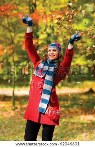 happy young woman in autumn scenery - stock photo