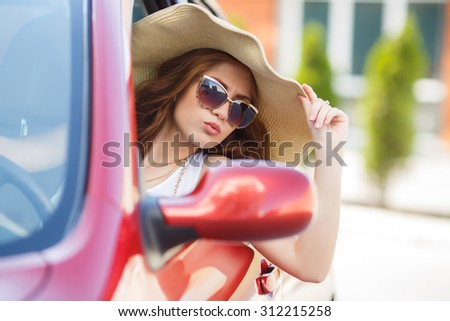 happy young woman in car driving on the road. Summer car travel freedom woman  with arms raised up cheerful and happy. Summer road trip traveler concept.  - stock photo
