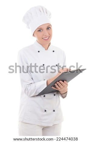 happy young woman in chef uniform writing something in clipboard isolated on white background - stock photo