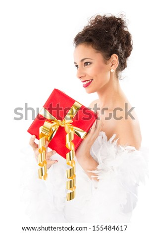 Happy young woman in elegant dress with gift box