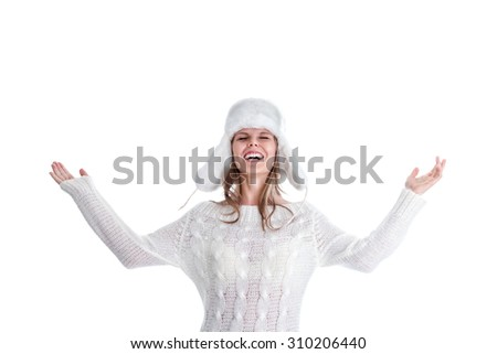 Happy young woman in heat winter sweater and fur hat - stock photo