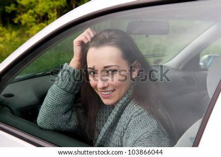 happy young woman in the car