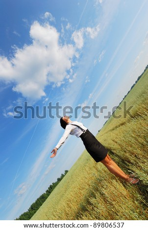 Happy young woman in the wheat field - stock photo