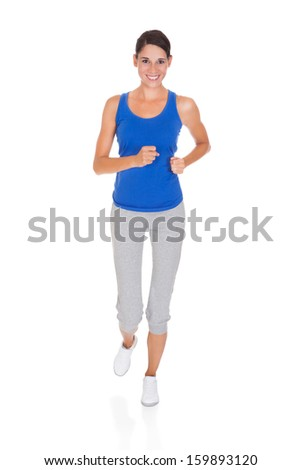 Happy Young Woman Jogging Over White Background - stock photo