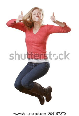 Happy young woman jumping giving thumbs up isolated on white background - stock photo
