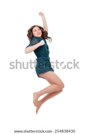 Happy young woman jumping isolated on a white background - stock photo