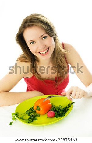 happy young woman keeping a diet and eating vegetables