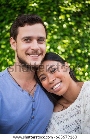 Happy Young Woman Leaning on Boyfriend Shoulder