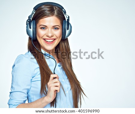 Happy young woman listening music with headphones. Isolated portrait. - stock photo